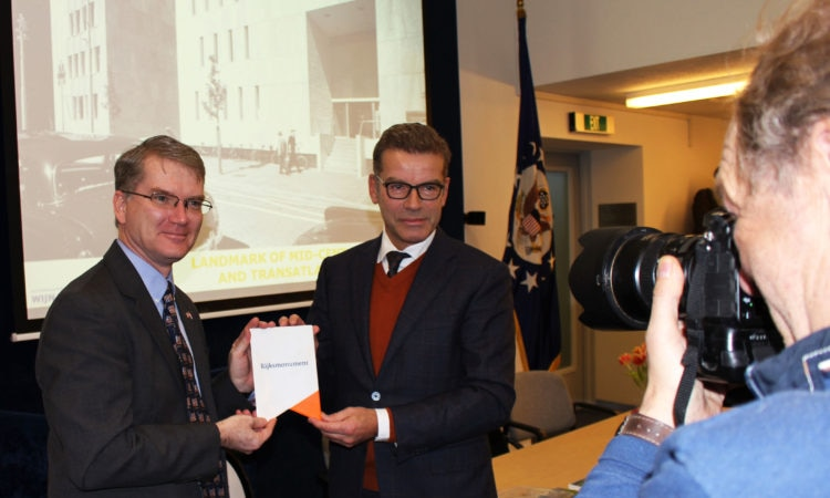Cees van 't Veen, Director National Cultural Heritage, on behalf of the Minister of Education presents the official designation plaque to Chargé d'Affaires Shawn Crowley.