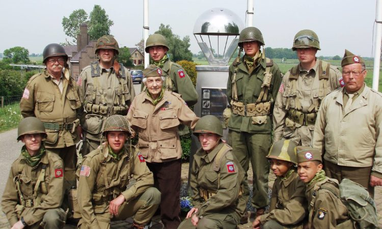 George Roth, the last remaining member of E-Company, 504th Parachute Infantry Regiment, with members of the Kazemattenmuseum in Grave during one of his last visits to the town he helped liberate during Operation Market Garden (Courtesy of Graafse Kazemattenmuseum.)
